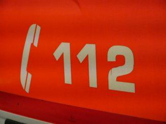 Siffrorna 112 och en telefonlur.