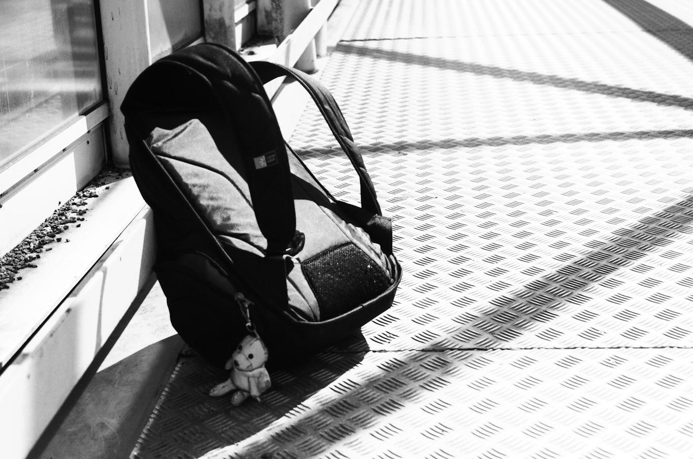 Ryggsäck med en reflex som föreställer en nallebjörn.