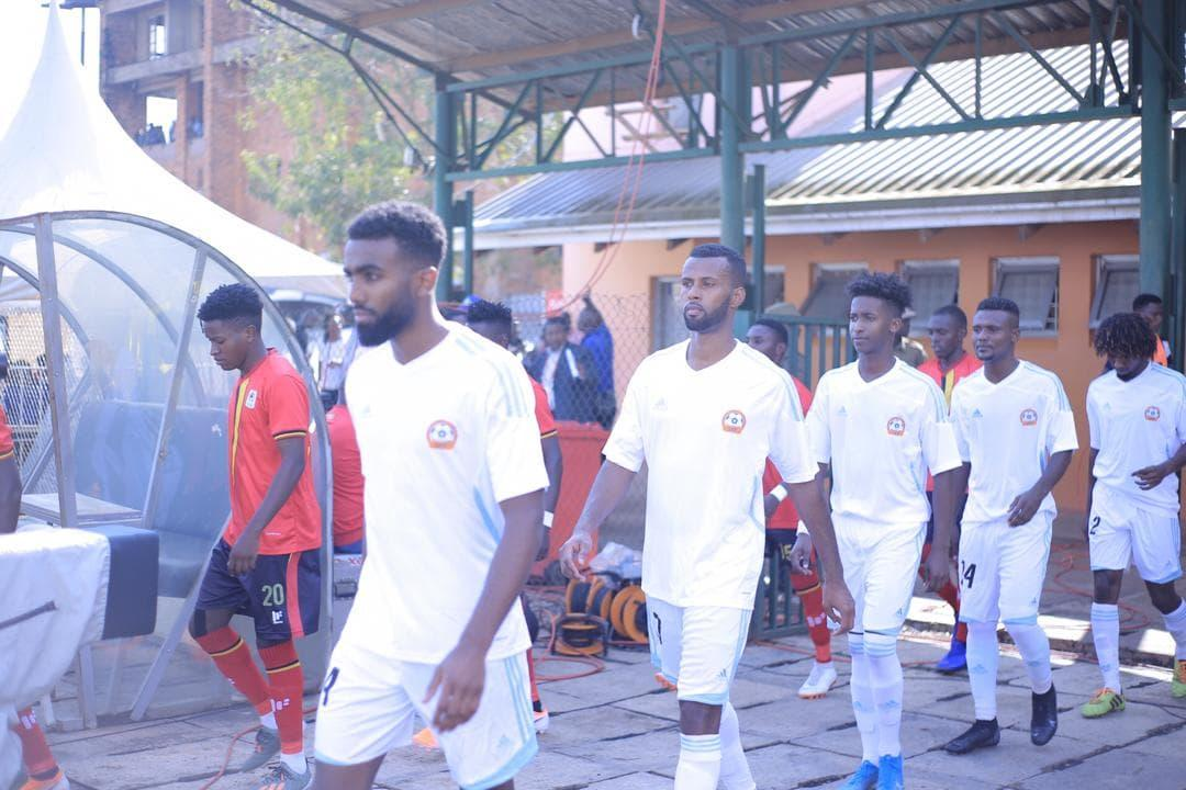 Fotbollsspelare på väg ut på planen