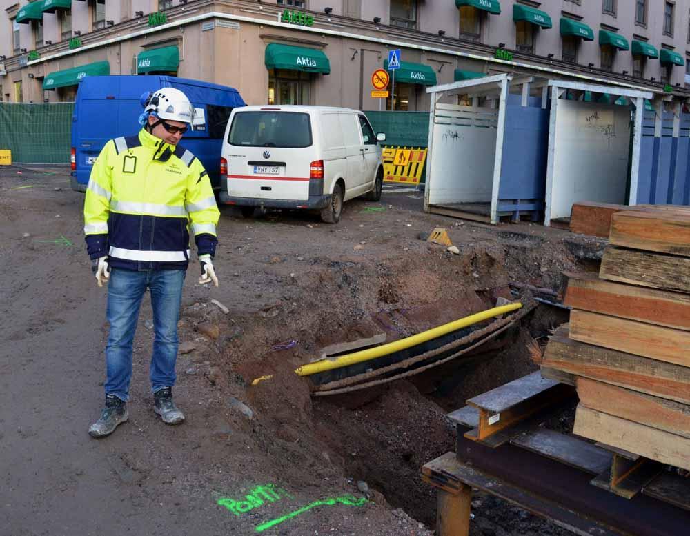 Byggarbetare vid grop